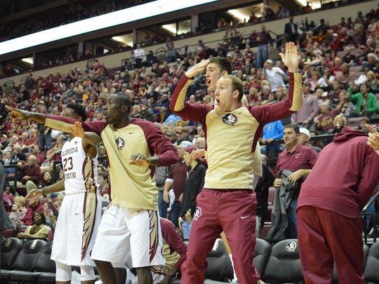 Florida State's bench reacts to a big play as the Seminoles knocked off the top-15 Cavaliers in Tallahassee.
