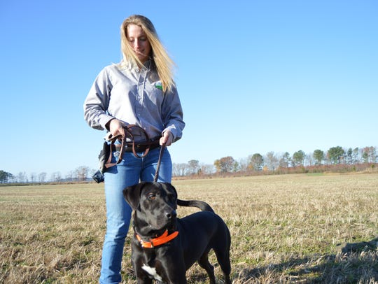 Lisa Buhr is shown with her canine, Mya, after graduation.