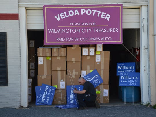 Ed Osborne hung a sign outside his auto repair business urging Velda Jones-Potter to enter the race for city treasurer.