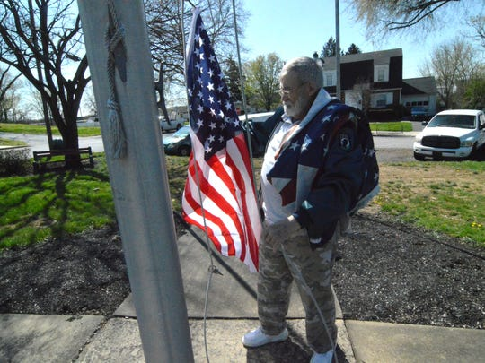 As he's done for three decades, 75-year-old James Brown replaces a worn out American flag he saw flaying in Newport Friday.