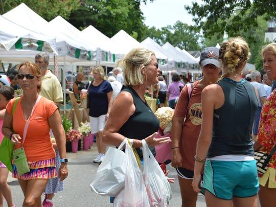 Hundreds gathered Tuesday at the Rehoboth Beach Farmers Market.