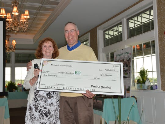 During the club's Spring Luncheon on Thursday, April 28, at the Neshanic Valley Golf Club, Neshanic Garden Club president Marion Nation presented Bruce Crawford, director of Rutgers Gardens, with a check for $1,000 to benefit his new concept for the Gardens.