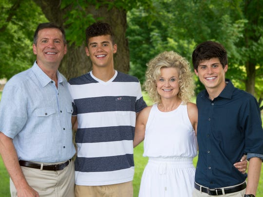 Stephen and Kari Kleinsmith, who have been married since 1989, with sons Jacob and Elijah.