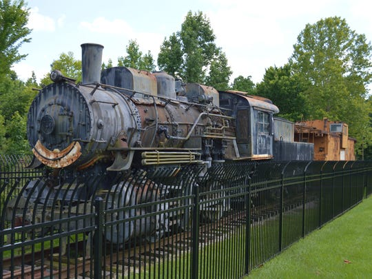 As a representation of it's past as a mill town commissary, a retired steam locomotive train is displayed beside the railroad tracks outside of the Tioga Heritage Museum.