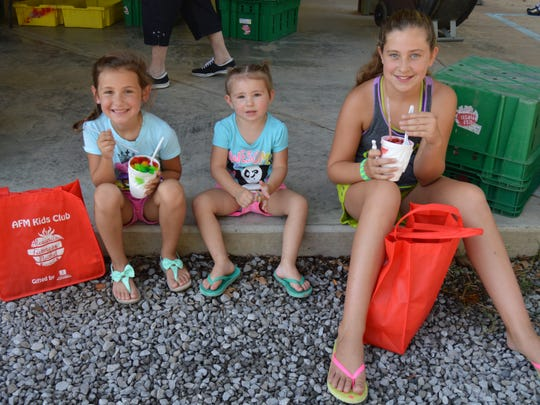 "Sisters Karsyn (11), Olivia (6) and Brooklyn (2) attended the Farmers Market Week kickoff event with their mother. Olivia said, ""It's been a lot of fun, and the food looks so yummy!"""