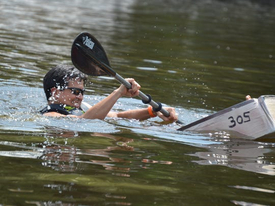 Alex Stroup, of Seaford, has that sinking feeling in his cardboard boat but he hung on to finish the race. The Cardboard Boat Regatta, part of the Reclaim Our River Nanticoke Series, is designed to raise awareness and money to help improve the river.