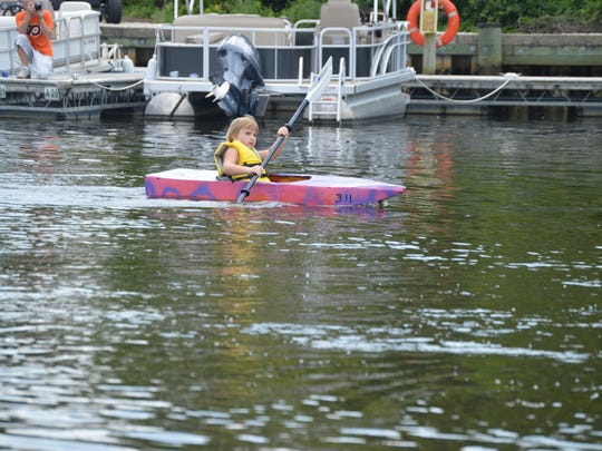 Sadie Wakefield, 5, of Lewes, paddles her cardboard board at the 3rd Annual Cardboard Boat Regatta in Blades.