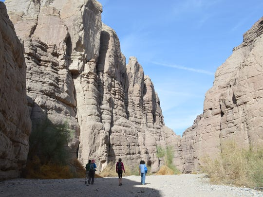 """Hikers at Painted Canyons, located within the Mecca Hills wilderness area in Riverside County. The area is overseen by the Federal Bureau of Land Management. Major movies have shot scenes in that area. """"Ben-Hur"""" coming out Aug. 19 is the latest to use the area for filming."""
