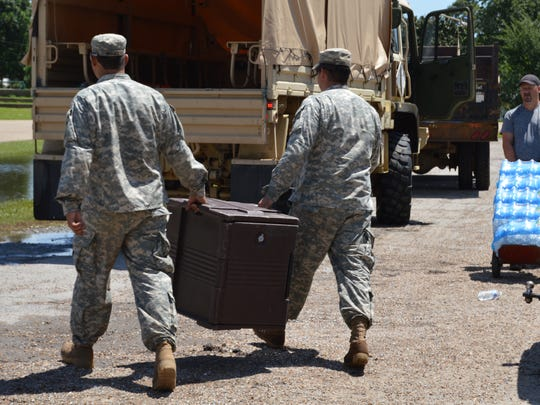 Red Cross volunteers and national guard soldiers delivered food and water to a shelter in Vermillion Parish on Monday.