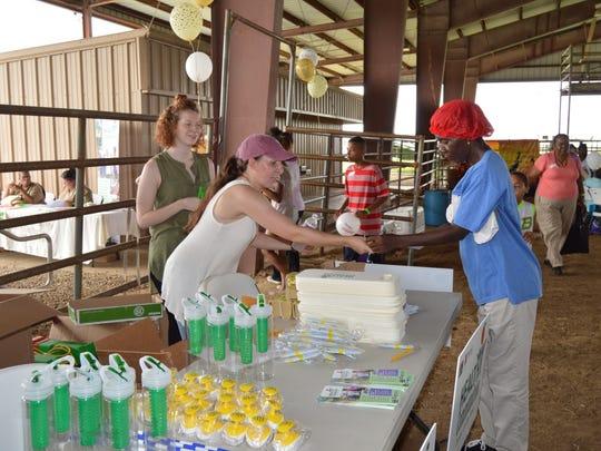 LSU AgCenter agent Victoria McDonald distributes nutrition