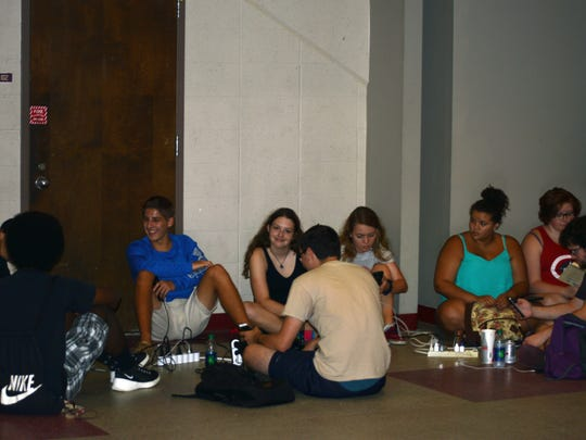 Students gathered at the Civic Center to enjoy air conditioning, charge their devices and get food.