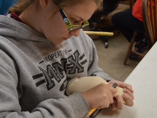 Emily Gresham, 14, works on her first big project with