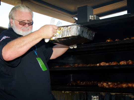 Myron Mixon checks on a batch of chicken legs he was smoking during the Sunday Brunch: Fired Up! event at Euphoria.