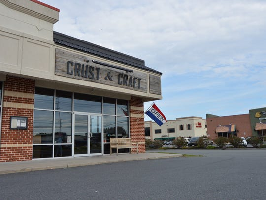 Crust & Craft owner Brenton Wallace opened his gourmet pizzeria on Route 1 last year.