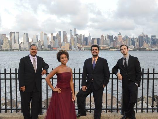 The Harlem Quartet is (from left) Ilmar Gavilan, Melissa White, Jaime Amador and Felix Umansky.