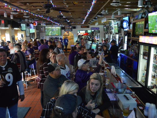 Fans cheer on the Ravens at Pit & Pub in Ocean City.