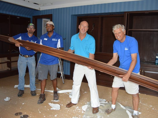 Habitat's Driver's Assistant James Young, Supervisor of Deconstruction Rito Fortes, The Hill Group's Steve Burris and Habitat volunteer Jerry Weick take down a crown molding at a John's Island residence