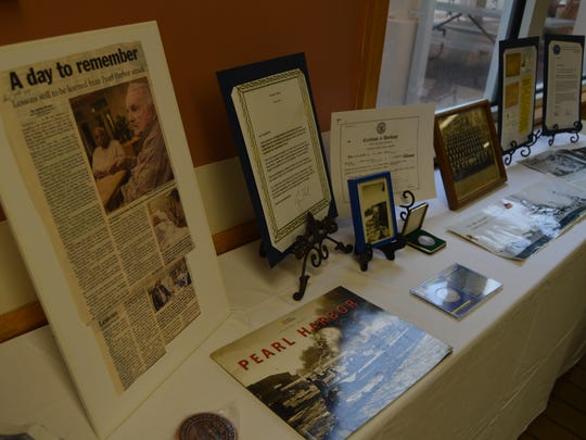 Memorabilia displayed during a ceremony honoring WWII veteran Ray Bashrum on the 75th anniversary of Pearl Harbor.
