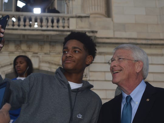 Sen. Roger Wicker, R-Miss., takes selfies Thursday with members of the Tupelo High School band. The band performed in Friday's inaugural parade.