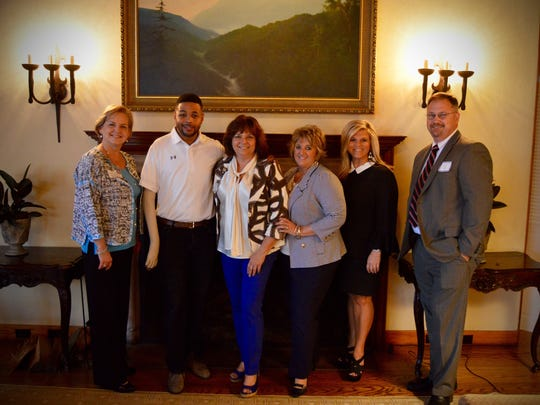 At the University Physicians' Association annual Shareholders' Dinner are UPA CEO Kim Friar, Inky Johnson, Director of Marketing  Donna Mowery, Director of Medical Billing Cindy Havens, VP of Client Strategy & Revenue Operations Christy Bailey and VP of Operations & COO Jerry Willis.