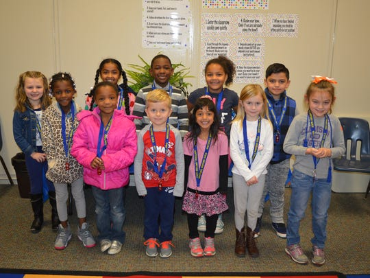 Whitehall Elementary School Writers' Guild K-2 inductees in the front row are Ni'Syiah Burton, Milana Thompson, Filip Gorczyca, Isabella Albert, Allison Stewart and Maddison Owens; and in the back row are Karleigh Galvin, Rosie Haywood, AJ Lee, Zaria Johnson and Stephen Arriaga Marimon. Not pictured: Malia Hawthorne and Skye Brown.