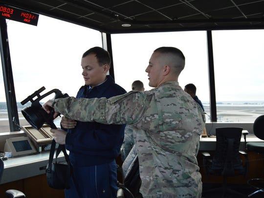 Cadet Eran East, a senior Faulkner student is given a lesson on Air Traffic Control equipment.