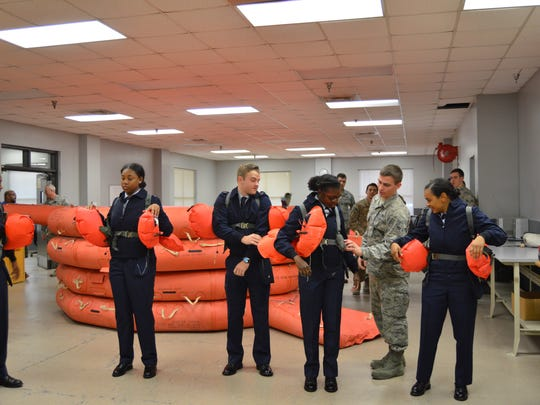 ASU cadets are given a combat rescue demo during their visit to Eglin.