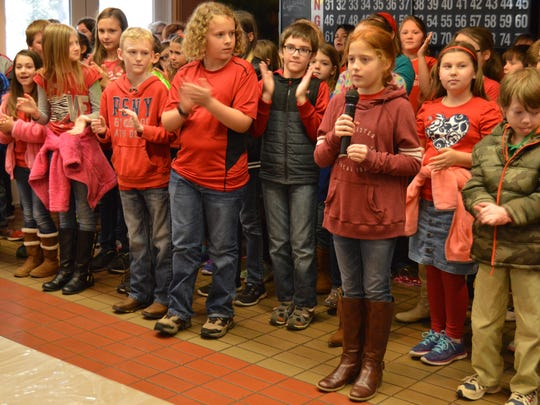 Marley Snoddy (pictured front) sings a solo during a concert with her classmates at the VA community living center. The group of fourth-graders from Pollock Elementary visited the VA to show appreciation to veterans for their military service.