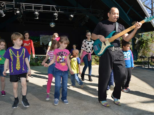 Kids were invited to dance on stage with The LaCour Trio at the Mardi Gras party.