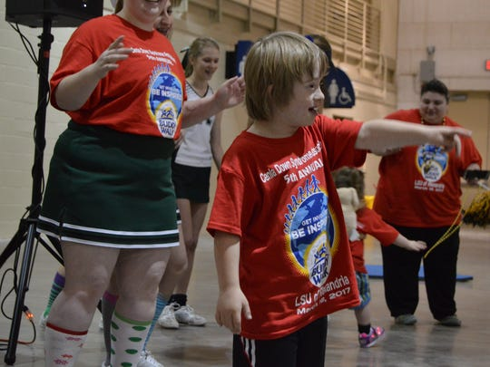 Asher Kenimer, 8, took center stage to dance when he