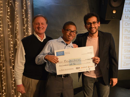 YEA student Joshua Walker (center) poses with Senior Vice President of Development for the Knoxville Chamber Mark Field (left) and Haseeb Qureshi, YEA class instructor, after receiving a $500 investment for his business Bewachen.