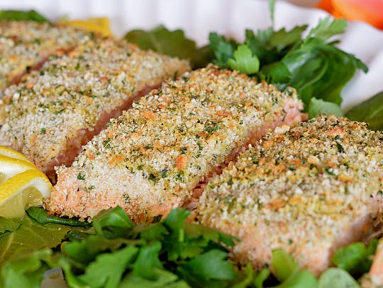 Roasted salmon fillets are topped with a bread crumb