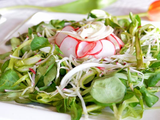 Extra shaved radishes and fennel top off this spring salad.