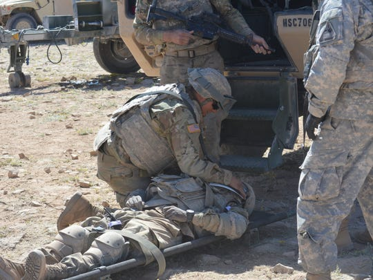Soldiers from the 127th Aviation Support Battalion conduct combat-medical drills during a recent live fire.