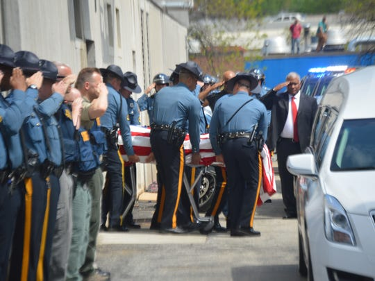The body of Cpl. Stephen J. Ballard, an 8?-year veteran of the Delaware State Police, is transferred from the medical examiner's office in Wilmington to Congo Funeral Home. Ballard was fatally shot as he attempted to flee from a gunman on Wednesday at a Bear Wawa.