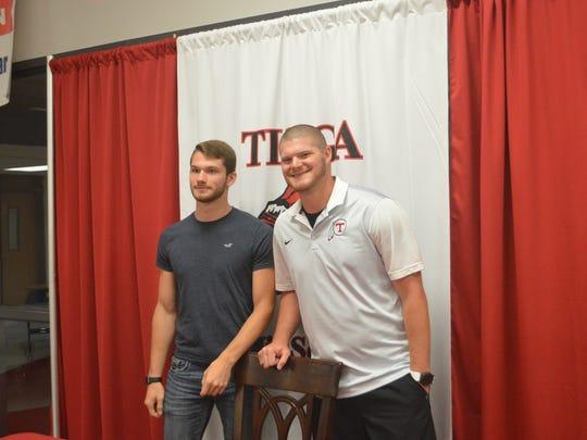 Tioga pole vaulter Nathan Moreau signed a celebratory form with Louisiana College Wednesday.