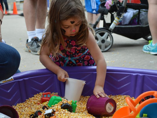 Children can play and learn in the Ed-Moo-cation Zone during Cows on the Concourse.