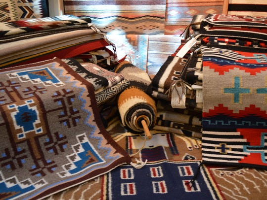 Items for sale at the Navajo rug auction at the Museum