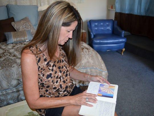 Lisa Schultz glances through a journal in the aunt