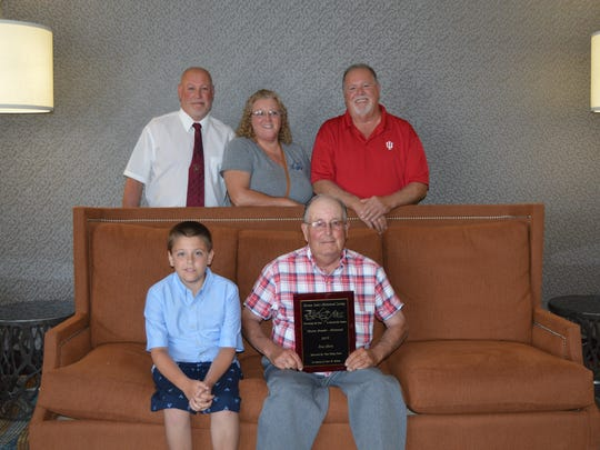 Rex Mort of Morts Dairy in Pierston, Indiana was the winner of the Historical Master Breeder Award. Rex is joined with his grandson, Dillon next to him and his children, Mark, Mary and Tim Mort behind him.