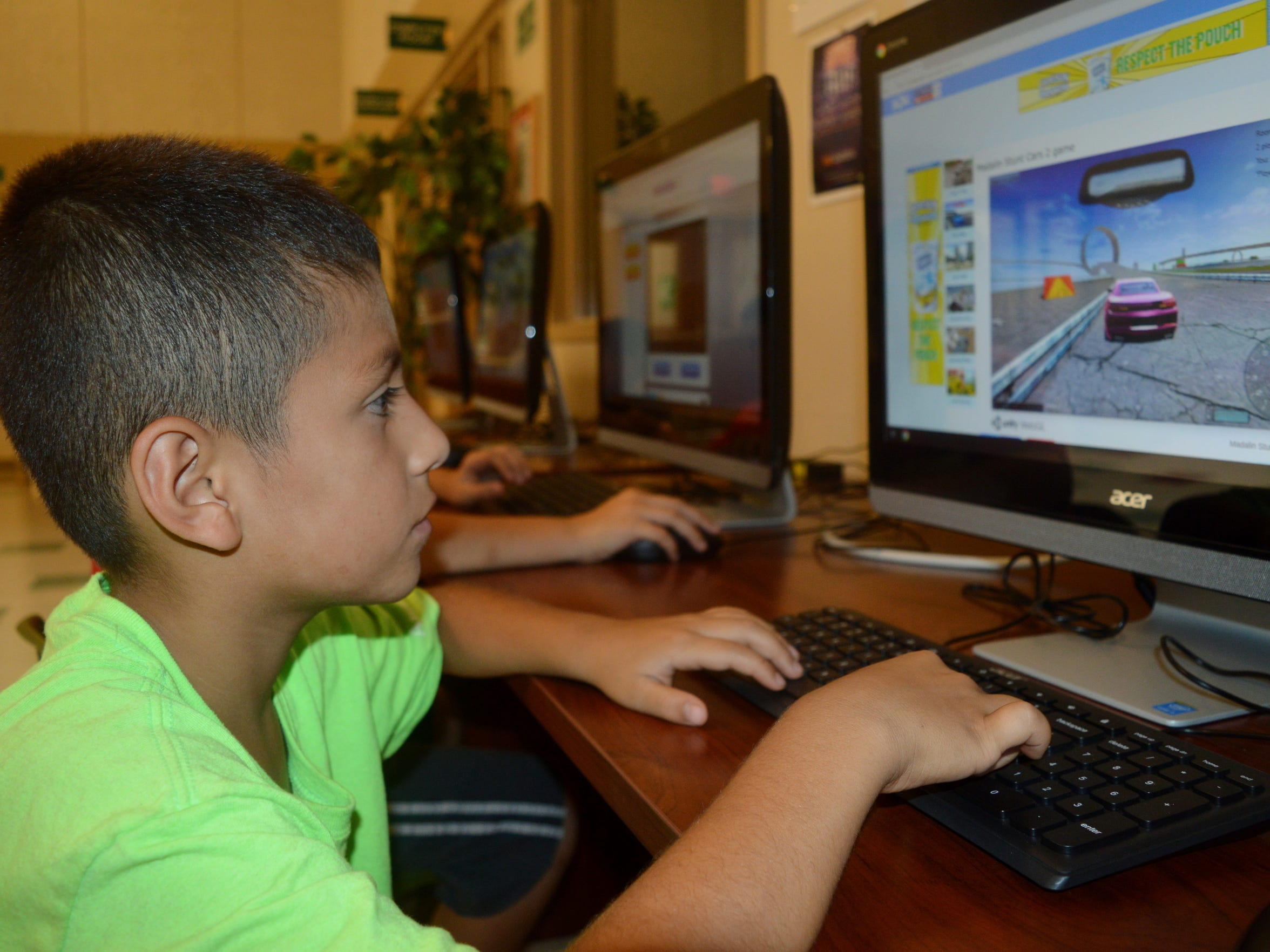 Ismael Cuevas plays a computer game on the last day of summer vacation at the Tulare Boys and Girls Club.