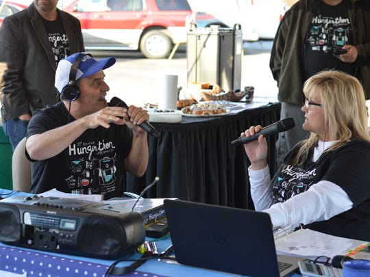 Kevin Howard and Liz Delany from 105.9 KGBX at a 2018 charity event.