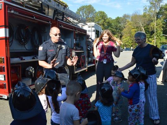 Randolph Fire Inspector and Battalion Chief Chris Ariemma talks to children at Center Grove Elementary School.