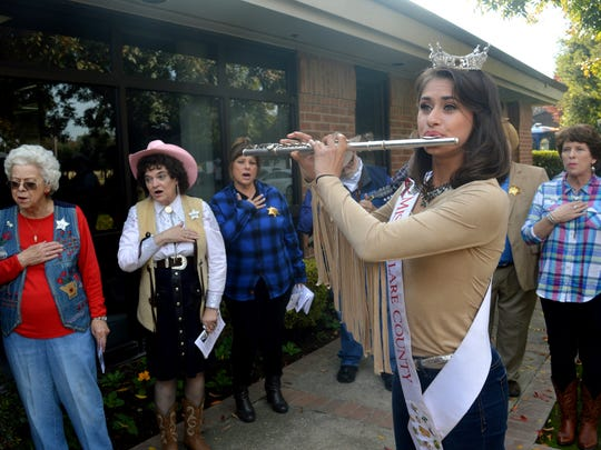 "Elizabeth Sartuche plays ""God Bless America"" on her flute while the Turkey Transit Singers sing along."