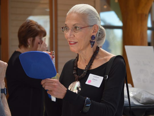 Evelyn Owen of Brookfield tries on jewelry from the