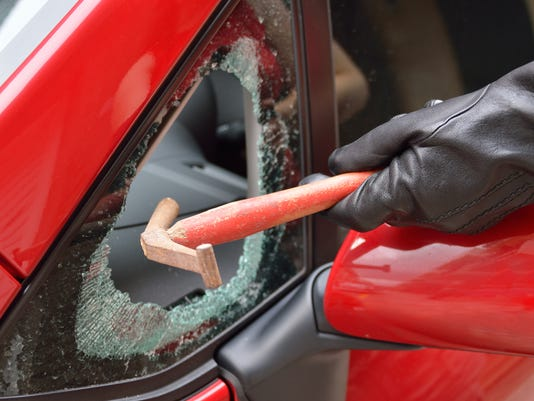 thief breaks car window