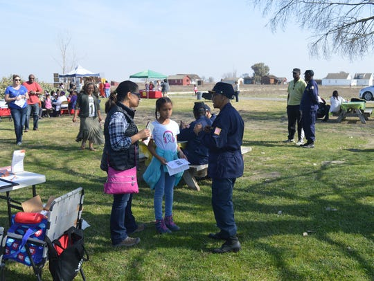 L. D. Slate, right talks to visitors during the  Allensworth