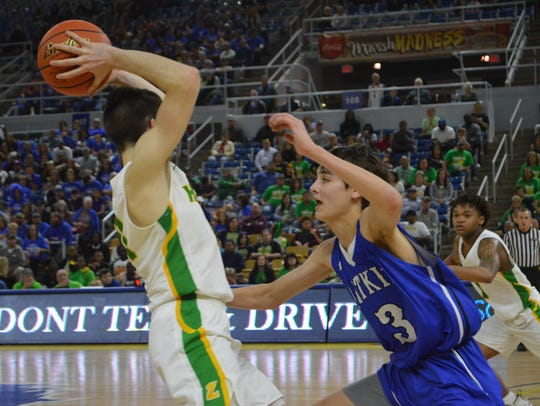 Pitkin sophomore guard Garrett Edwards (3) guards Zwolle's