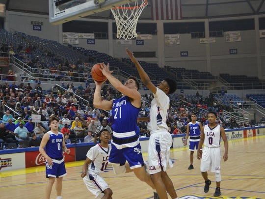 St. Mary's senior Aaron Howell (21) goes for 2 against Lafayette Christian in the Division IV finals Friday.