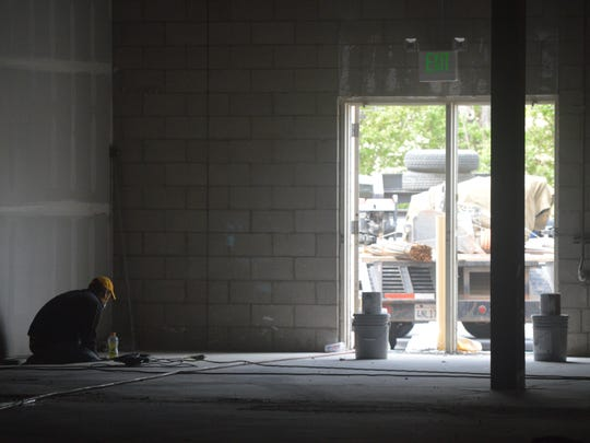 Demolition and construction workers were on site this week at the former Mervyns building in Tulare.